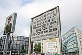 BERLIN, GERMANY - SEPTEMBER 21:   Checkpoint Charlie on September 21, 2013 in Berlin, Germany. It's the best-known Berlin Wall crossing point between East and West Berlin during the Cold War. — Stock Photo