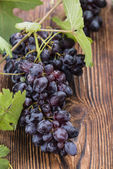 Blue Grapes on wood — Stock Photo