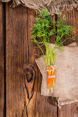 Carrot Injection on wooden background — Stock Photo