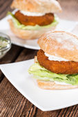 Homemade Fish burger on wooden background — Stock Photo
