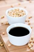 Portion of Soy Sauce and soy beans — Stock Photo