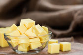 Block of Cheese in bowl — Stock Photo