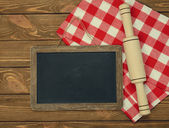 Writing board napkin and rolling pin — Stock Photo