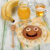 Pancakes with banana — Stock Photo
