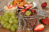 Chocolate cereal with fruit — Stock Photo