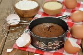 Chocolate cake and ingredients for baking — Stock Photo
