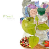 Bottle of water and a green leaf — Stock Photo
