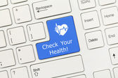 White conceptual keyboard - Check Your Health (blue key with hea — Stock Photo