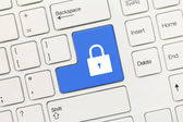White conceptual keyboard - Lock icon (blue key) — Stock Photo