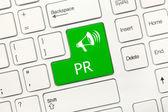 White conceptual keyboard - PR (green key) — Stock Photo