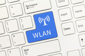 White conceptual keyboard - WLAN (blue key) — Stock Photo
