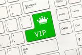 White conceptual keyboard - VIP (green key) — Photo