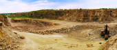 Panorama of granite quarry with Loader — Stock Photo