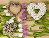 White and violet tulips on the table with heart — Stock Photo