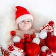 Cute baby Santa lying in a basket — Stock Photo #59394325