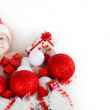 Cute baby Santa lying in a basket — Stock Photo #59394329