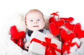 Boy with a gift box and hearts — Stock Photo