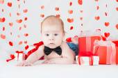 Boy with a gift box and hearts. Valentine day concept — Stock Photo
