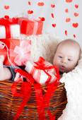 Gift basket with gift boxes, hearts and Cupid. Valentines Day — Stock Photo