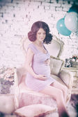Pregnant woman with blue and white balloons — Stock Photo
