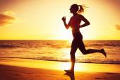 Fitness woman running at sunset — Zdjęcie stockowe