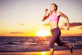 Fitness woman running at sunset — Stock Photo