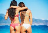 Girls in Bikinis on the Beach — Stock Photo