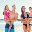 Happy Mixed Race Family on the Beach — Stock Photo #54335943
