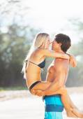 Attractive Couple Kissing on the Beach — Stockfoto