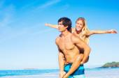 Attractive Couple Playing on the Beach — Stock Photo