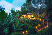 Tropical Home in the Jungle at Sunset — Stock Photo