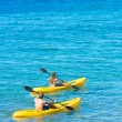 Man and Woman Kayaking in the Ocean — Stock Photo #59845305