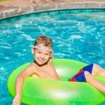 Young Kid Having Fun in the Swimming Pool — Stock Photo #59845639