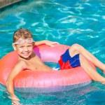 Young Kid Having Fun in the Swimming Pool — Stock Photo #59845769