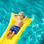 Boy Relaxing and Having Fun in Swimming Pool on Yellow Raft — Stock Photo #59845873