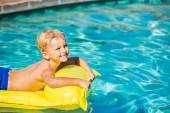 Boy Relaxing and Having Fun in Swimming Pool on Yellow Raft — Stock Photo