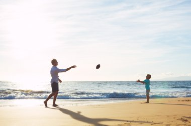 Father and Son Playing Catch Throwing Football