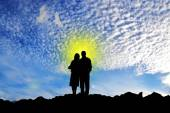Loving couple on a background of mountains. — Stock Photo
