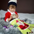 Child with gift — Stock Photo #57950053