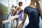 Group of five young dancers trained in a dance class near the ba — Stock Photo