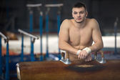 Portrait of a handsome gymnast with naked torso gymnastic horse  — Stock Photo
