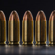 Number pistol cartridge 9 mm caliber — Stock Photo #70956633