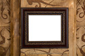 Wooden old frame on the wall with empty content — Stock Photo