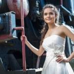 Portrait of happy wedding bride near the old steam locomotiv — Stock Photo #73942937