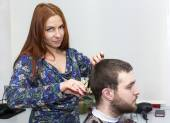 Girl doing hairstyle — Stock Photo