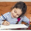 Girl draw with crayons on paper — Stock Photo #54240131