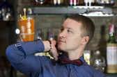 Young man working as a bartender — Foto Stock