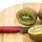 Kiwi fruit on a cutting board — Stock Photo #54581837