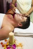 Man engaged in Ayurvedic spa treatment — Stock Photo