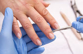 Processes work on a manicure — Stock Photo